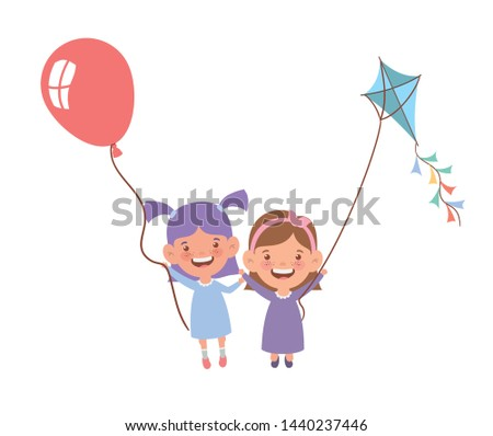 baby girls smiling with helium balloon in hand