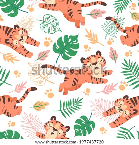 Baby tiger seamless pattern. Cute childish cartoon tigers, paw and tropical leaves. Jungle animal, wild cats, kids vector wallpaper. Pattern wallpaper with tiger, baby childish background illustration