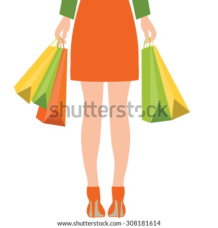 back of woman holding shopping
