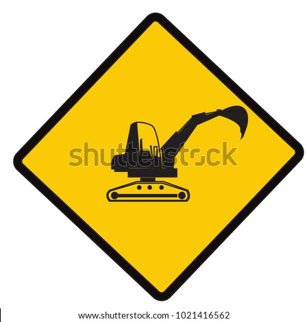 backhoe on duty  caution road