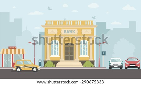 Bank building with city skylines behind.