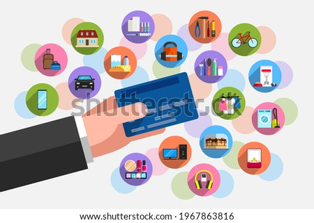 Bank plastic card in person's hand and plenty of icons of goods around it. Concept of purchasing power, cashless payment for goods and services, purchases on credit Foto stock ©