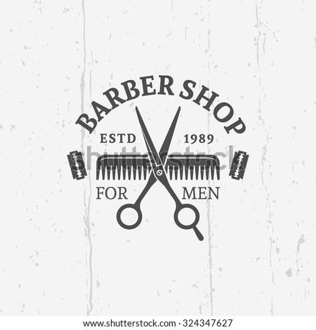 Barber shop vector vintage label, badge, or emblem on gray background with grunge texture