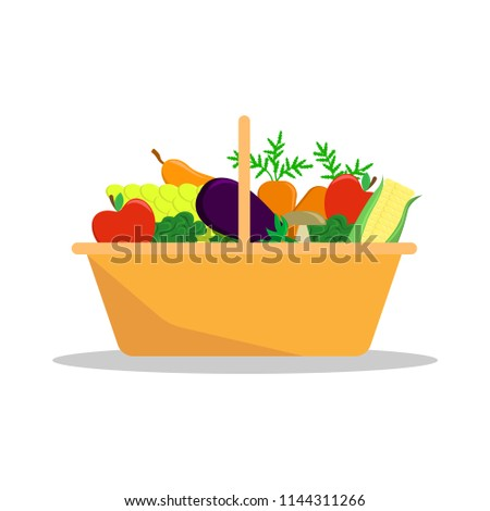 Basket with a seasonal harvest. Farmer fruit and vegetables. #1144311266