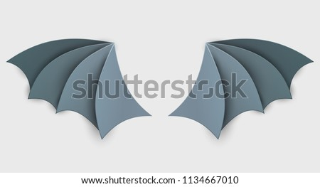 Bat wing in trendy paper cut craft graphic style. Modern design for advertising, branding greeting card, cover, poster, banner. Vector illustration.