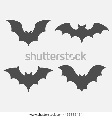 Bats vector set isolated on white background. Dark silhouettes of bats flying in a flat style.