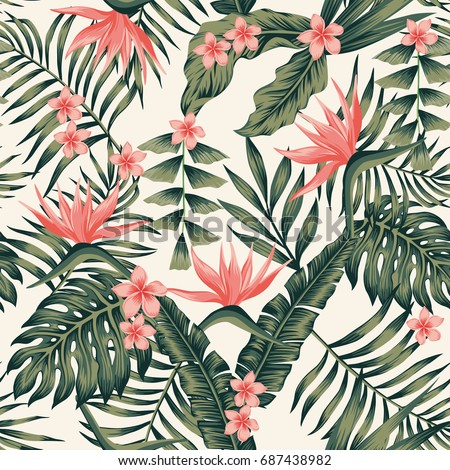 Beach cheerful seamless pattern wallpaper of tropical dark green leaves of palm trees and flowers bird of paradise (strelitzia) plumeria on a light yellow background - Shutterstock ID 687438982