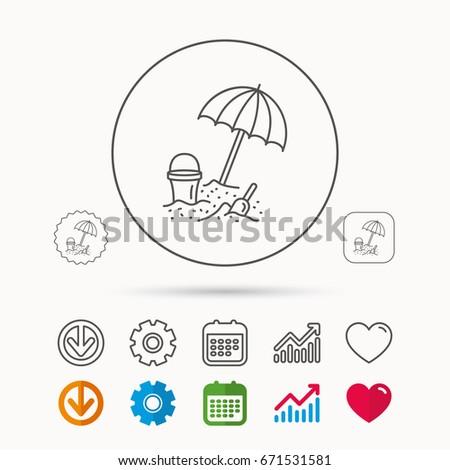 beach umbrella in sand icon
