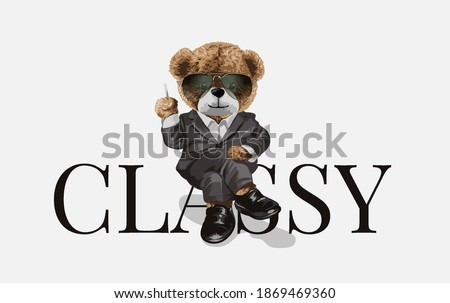 bear doll in suit sitting on