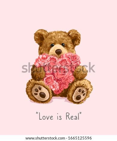 bear toy holding roses heart