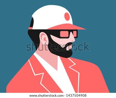 bearded man wearing suit