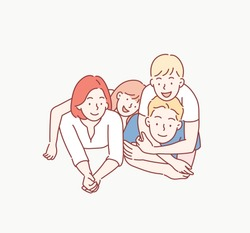 Beautiful and happy smiling young family in white T-shirts are hugging and have a fun time together while lying on the floor and looking on camera. Hand drawn style vector design illustrations.