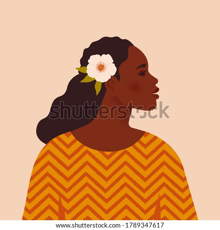 Beautiful black woman. Young african american. Portrait of young woman with beautiful face and hair. Side view. Isolated on a beige background.