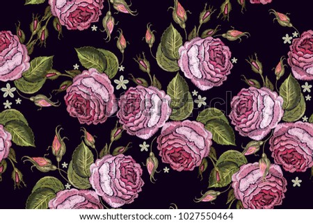 Beautiful buds of pink roses classical embroidery on black background. Embroidery roses seamless pattern. Template for clothes, textiles, t-shirt design