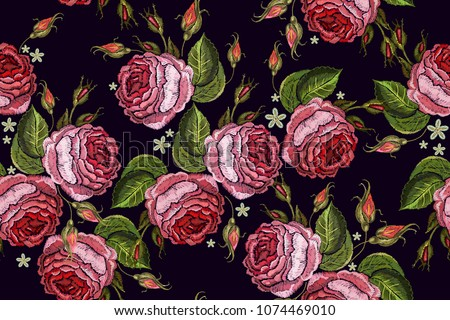 Beautiful buds of pink roses classical embroidery on black background. Template for clothes, textiles, t-shirt design. Embroidery spring roses seamless pattern