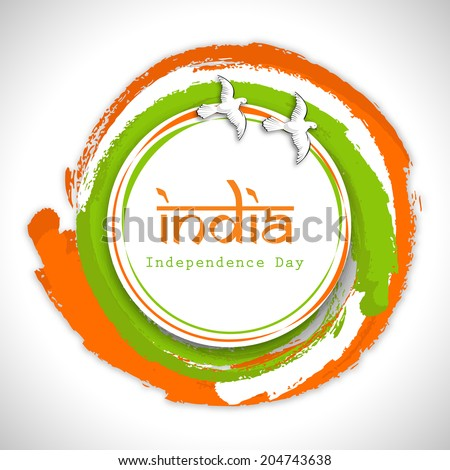 Beautiful circle in Indian National Flag colors with flying pigeons and stylish text India on grey background for 15th of August Indian Independence Day celebrations