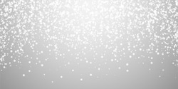 Beautiful falling snow Christmas background. Subtle flying snow flakes and stars on light grey background. Actual winter silver snowflake overlay template. Brilliant vector illustration.