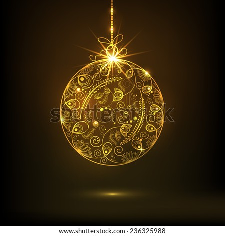 Beautiful floral design decorated golden X-mas Ball on brown background for Merry Christmas and Happy New Year celebrations.