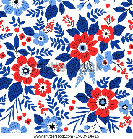 Beautiful floral pattern in small abstract flowers. Small red and blue flowers. White background. Ditsy print. Floral seamless background. The elegant the template for fashion prints.