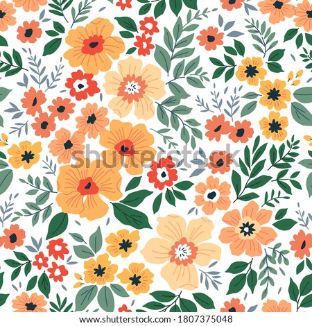 Beautiful floral pattern in small abstract flowers. Small yellow and orange flowers. White background. Ditsy print. Floral seamless background. The elegant the template for fashion prints.