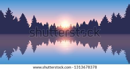 beautiful lake at sunrise pine