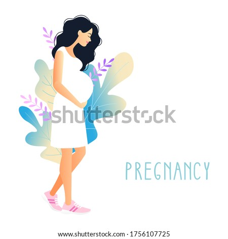 beautiful pregnant woman with hand on her stomach on a background of foliage. young woman stroking belly. Pregnancy. Stock photo ©