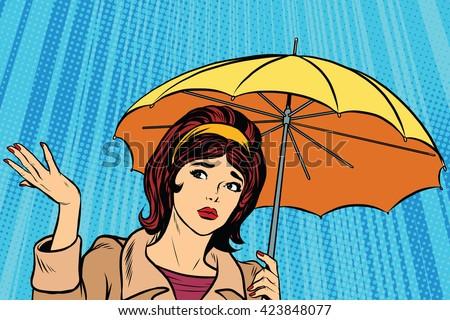 beautiful sad girl in rain with