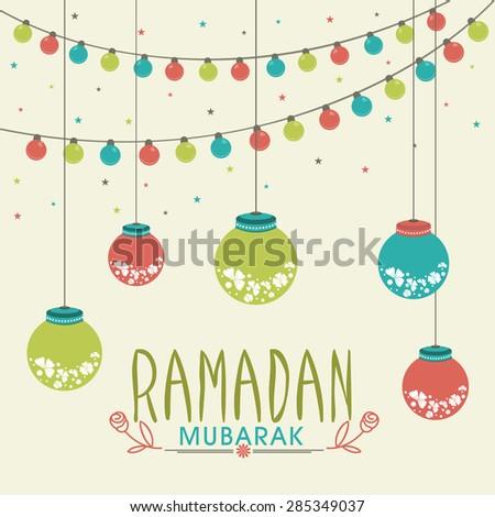 Beautiful traditional lanterns with colorful lights garland on stars decorated background for Muslim community festival, Ramadan Mubarak celebration. #285349037