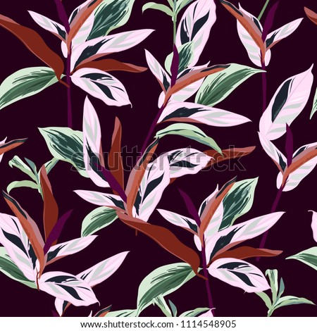 Beautiful tropical leaves. Seamless graphic design with amazing palms. Fashion, interior, wrapping, packaging suitable. Realistic palm leaves.vector on dark maroon background