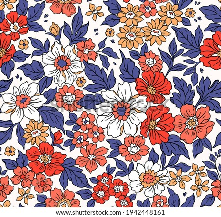 Beautiful vintage floral pattern in small realistic flowers. Small red and coral flowers. White background. Liberty style print. Floral seamless background. The elegant the template for fashion prints