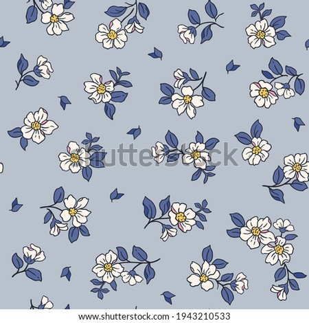 Beautiful vintage floral pattern in small realistic flowers. Small white flowers. Mauve background. Liberty style print. Floral seamless background. The elegant the template for fashion prints.