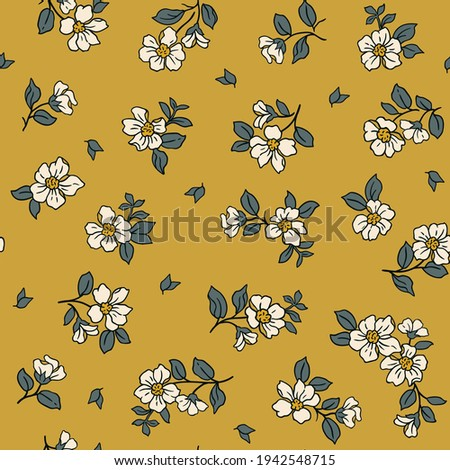 Beautiful vintage floral pattern in small realistic flowers. Small white  flowers. Old gold background. Liberty style print. Floral seamless background. The elegant the template for fashion prints.