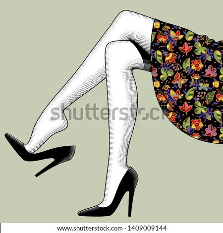 beautiful woman's legs in black