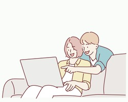 Beautiful young couple is using a laptop, hugging and smiling while sitting on couch at home. Hand drawn style vector design illustrations.