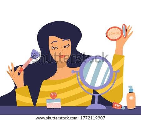 Beautiful young woman character doing make up. Table with makeup, cosmetics and wound mirror. Girl holding brush and powder. Vector flat cartoon illustration in trendy style. Сток-фото ©