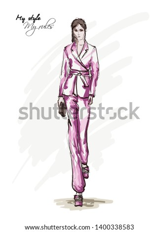 Beautiful young woman  in a pink pantsuit. Hand drawn fashion girl. Fashion model posing. Sketch. Vector illustration.