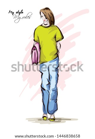 Beautiful young women in a yellow T-shirt and blue , breeches. Hand drawn fashion girl. Fashion model posing. Sketch. Vector illustration.