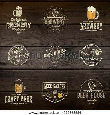 Beer badges logos and labels for any use, logo templates and design elements for beer house, bar, pub, brewing company, brewery, tavern, restaurant, on wooden background texture