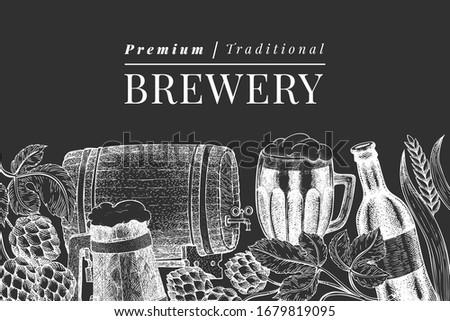 Beer glass mug and hop design template. Hand drawn vector pub beverage illustration on chalk board. Engraved style. Vintage brewery illustration. ストックフォト ©