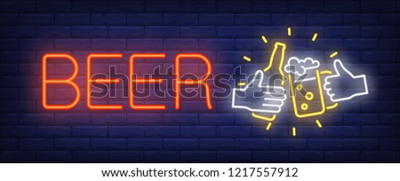Beer mug and bottle neon sign. Glowing neon sign with bottle and cup of beer in human hands on dark blue brick background. Can be used for bars, night advertisement, shops