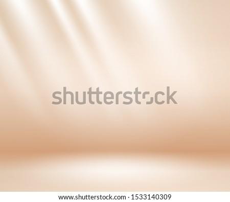 Beige studio background. Neutral background with soft rays. Warm soft light studio lighting. Photostudio soft box neutral lighting.