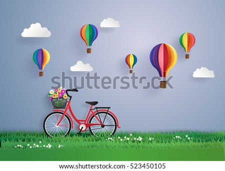 Bicycle in the garden with colorful hot air balloon . digital craft and paper art style.