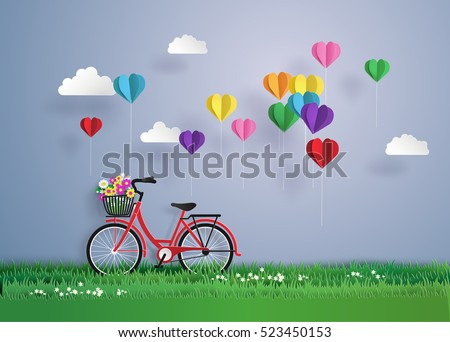 Bicycle in the garden with colorful hot air balloon heart sharp.origami and paper art style.