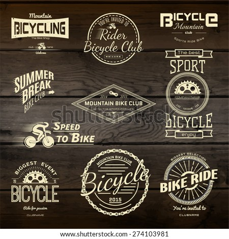 Bicycle set badges logos and labels for any use on wooden background texture EPS10