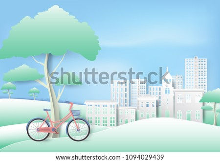Bicycle under the tree in park on blue sky paper art, paper cut style background