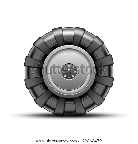 Big black wheel of tractor isolated on white background