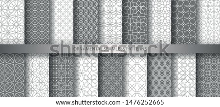 Big collection of light grey geometrical classic patterns. White, gray grille texture in Arabic, Oriental style. Set of seamless vector backgrounds.