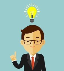 Big idea concept with man and lightbulb. Symbol of having an idea with businessman pointing at light bulb