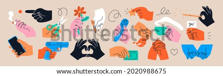 Big set of Colorful Hands holding stuff. Different gestures. Hands with cup, magic wand, banner, money, wine glass, microphone, star, etc. Hand drawn Vector illustration. All elements are isolated