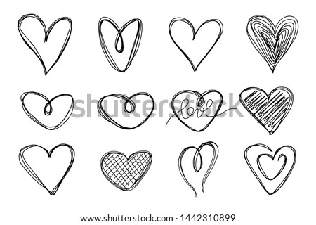 Big set of hand-drawn hearts on a white background. Doodle style. Vector illustration.